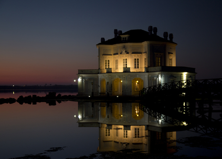 nocturnal: Nocturnal view of the Bourbon royal hunting house on the Fusaro Lake, Pozzuoli, Naples, Italy Stock Photo