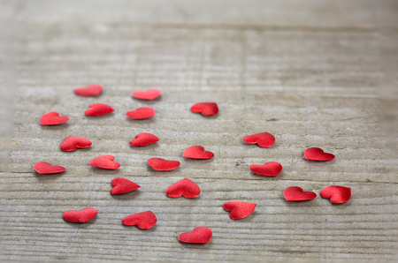 shaped: Heart shaped confetti on wooden background