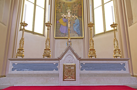 candelabrum: Altar in an italian  modern church with pyx and candelabrums Stock Photo
