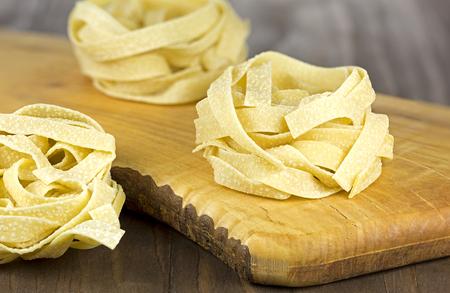 durum wheat semolina: Tuscany durum wheat semolina pasta on wooden background