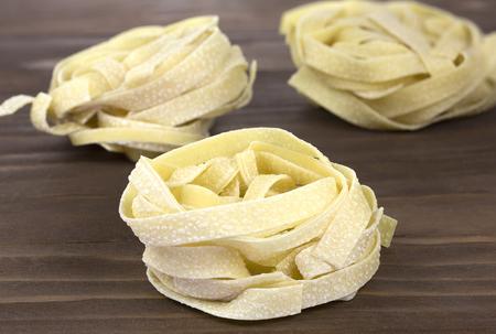 durum: Tuscany durum wheat semolina pasta on wooden background