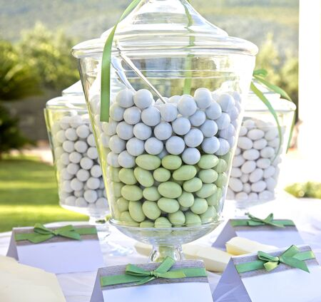sugared almonds: Multi colored sugared almonds in glass containers Stock Photo