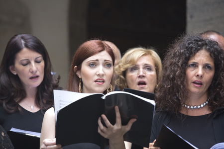 voices: Naples, Italy. June 19, 2016: Members of the Choir Pietà dei Turchini singing Haendel Halleluja in the  St. Martins Charterhouse,  a former monastery complex, now a museum, in Naples, southern Italy