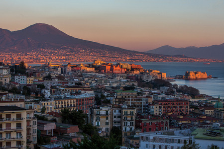 Aerial view of Naples with castle and Vesuvius mount at the sunset