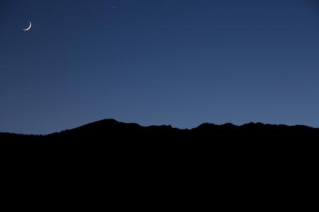 Mountain skyline wth moon in Alto Adige, Italy