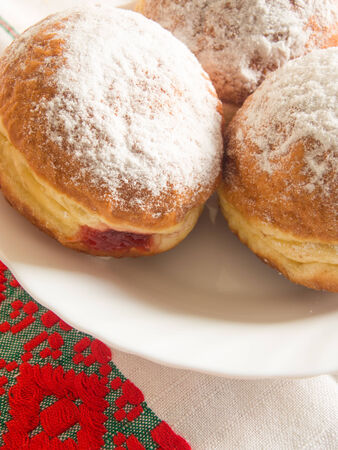 filed: donuts filed with jam and powdered sugar above