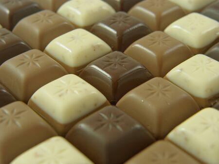 white chocolate: pieces of dark, milk and white chocolate Stock Photo