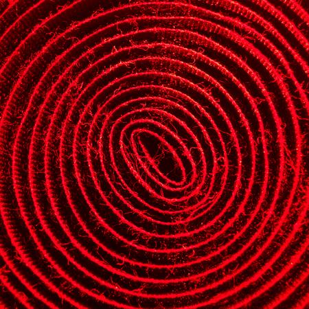 velcro: red illuminated spiral of velcro band Stock Photo