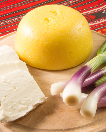 trencher: polenta cheese and fresh green onion on a trencher