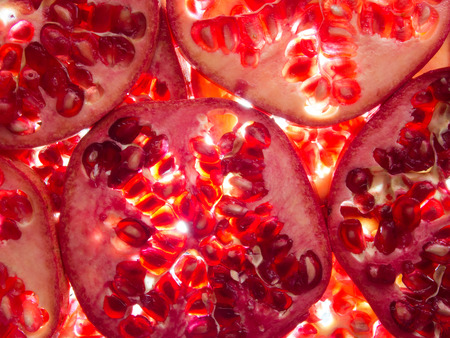 pommegranate: pomegranate slices lit from below