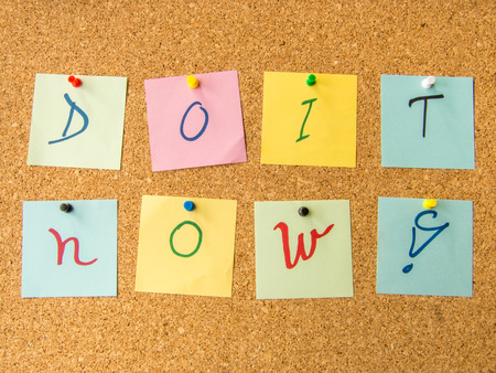 motivator: motivational message do it now with exclamation mark written on post it notes Stock Photo