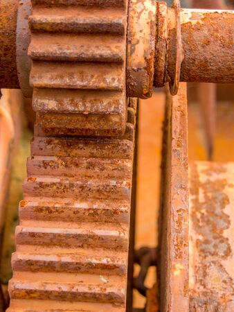 scraped: close up on scraped rusted cogwheel