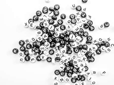 typesetter: heap of round letters black and white pattern Stock Photo
