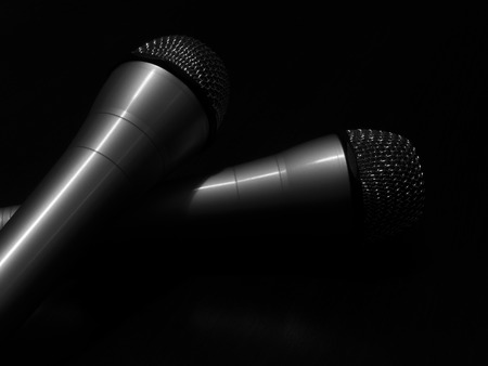microphone: black and white two microphones concept Stock Photo
