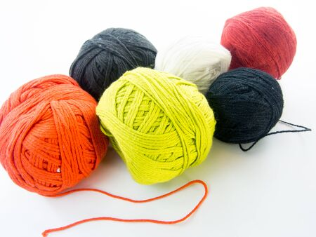 color balls: multi color balls of wool over white background