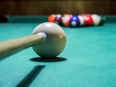billard: pool game ready to start with pool cue against white ball