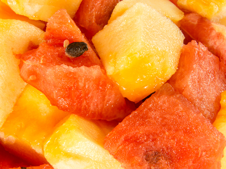 close up on fresh ripe delicious watermelon and yellow melon chops Stock Photo
