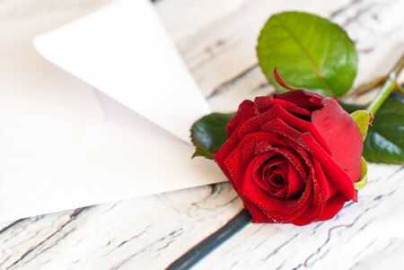 beautiful red rose and letter envelope love valentines day concept Stock Photo