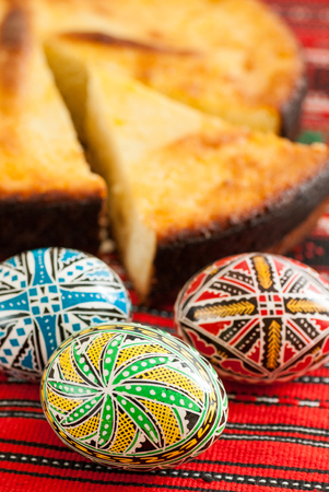 traditional romanian easter bread pasca with cheese and raisins and nicely decorated easter eggs orthodox tradition Stock Photo