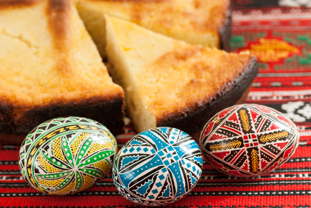 traditional romanian easter bread pasca with cheese and raisins and nicely decorated easter eggs orthodox tradition Stock Photo - 76330931