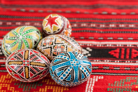 nicely decorated easter eggs on traditional rug