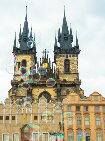 church of our lady before tyn in prague viewed trough soap bubbles happy holiday concept