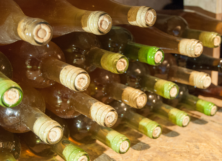 bottles with wine stacked in rack