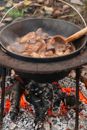 delicious pork meat and organs traditionally cooked in the cauldron