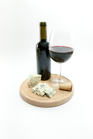 glass and bottle with red wine and roquefort cheese aside wine tasting luxury concept Reklamní fotografie