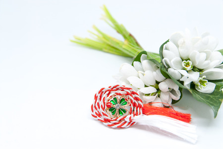 snowdrops and red and white string martisor on white with copy space