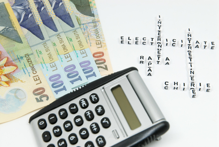 romanian currency leu ron and calculator and words written in romanian representing household monthly expenses concept photo Foto de archivo