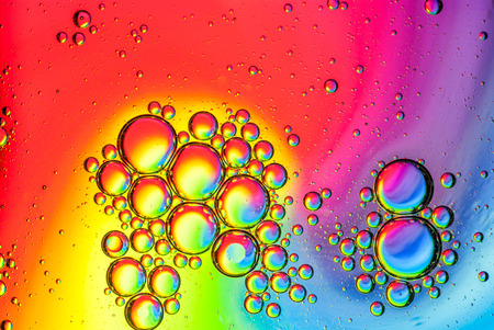 Oil bubbles on water abstract multicolored background