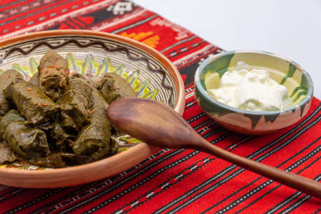 wine leafs rolls stuffed with meat and vegetables or just rice and vegetables romanian dish of arabic influence served or without cream on a traditional cloth