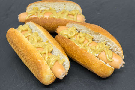 delicious homemade hot dogs on black slate close up photo Stock Photo