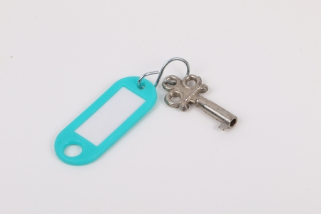 old small key and keyholder lying on the table Stok Fotoğraf - 87392958
