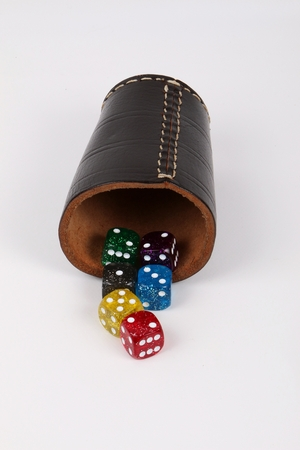 colorful dices and a cup