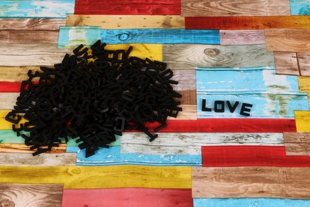 black wooden letters in a colorful studio with a word love Stock Photo