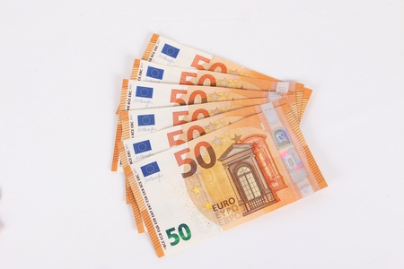 many fifty euros are lying in the studio Stock Photo