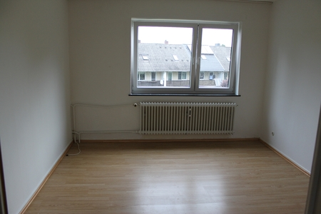 empty room with a windown and a heating Stockfoto