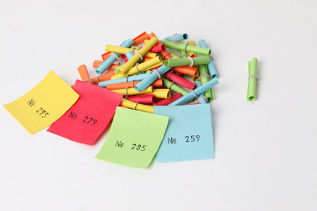 Colorful tombola tickets with four winning numbers in the studio