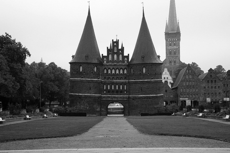 holsten gate in the city black and white