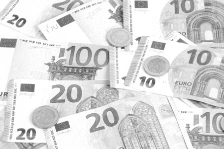 Black and white close up of a heap of different euros in the studio Stok Fotoğraf - 133512643