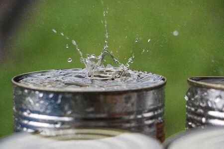 Rain is splashing on the top of a can outdoor Stock Photo