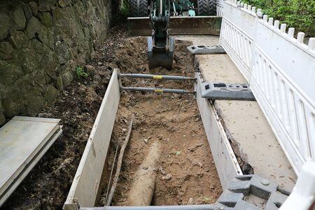 Small building site with pipes and a dredge