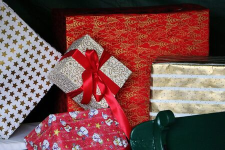 Close up of a heap of beautiful colorful christmas gifts