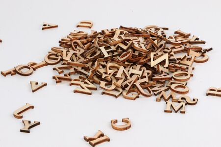 Heap of small wooden letters in the white studio Stok Fotoğraf - 131958169