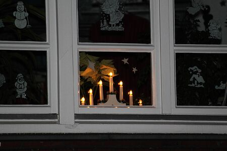 Beautiful christmas decoration with candles in the window Stok Fotoğraf - 131958249