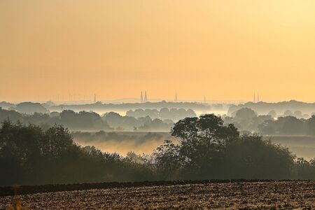 Beautiful landscape in the morning with fog and a skyline at the horizon Banco de Imagens