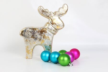 Beautiful shiny and colorful christmas decoration is standing in the white studio Stok Fotoğraf