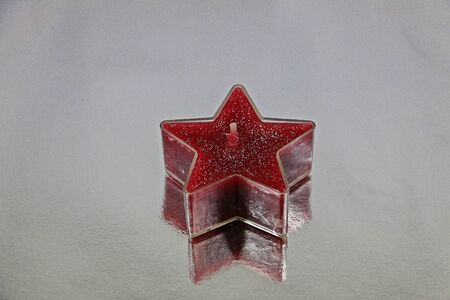 Beautiful red and silver sparkling christmas star on a silver reflection ground Stok Fotoğraf